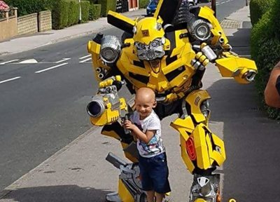 Father dresses as Transformer on son's first day back at school thumbnail