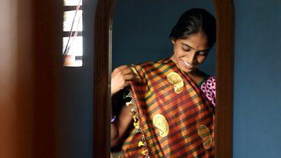 Woman wears a sari