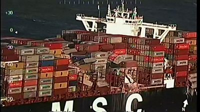 View of side of MSC Zoe cargo ship with crushed containers perched precariously (2 January)