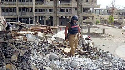 Man in rubble