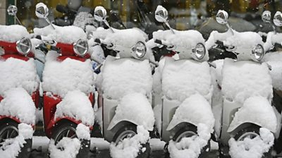 Snow on moped in Zurich