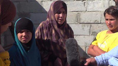 Latifa with her grandchildren