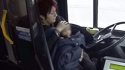 Toddler with bus driver