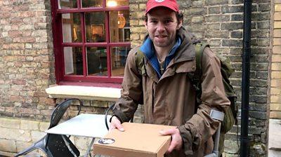 Man holding a pizza box