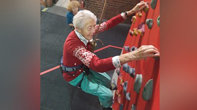 Greta on a climbing wall