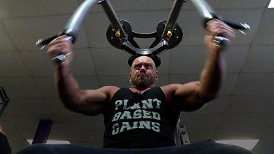 Paul Kerton working out in a gym