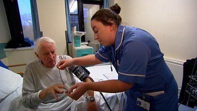 Nurse treating patient