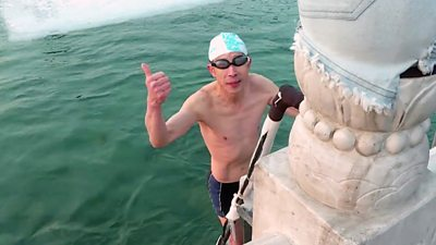 Swimmer takes icy plunge