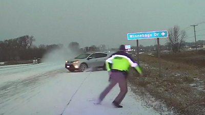 Wisconsin police officer narrowly avoids sliding car