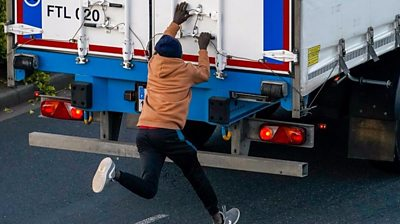 Migrant trying to open back of lorry