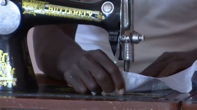 A former Boko Haram fighter sewing