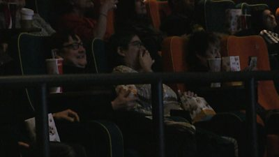 People watching a screening