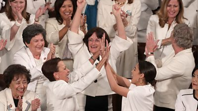 Democratic women cheer during Trump's State of the Union speech