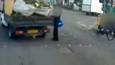 Schoolboy in traffic light near miss