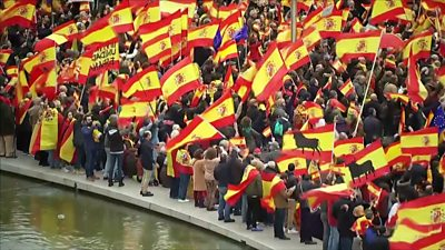crowds with Spanish flags