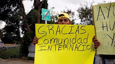 Man holding placard