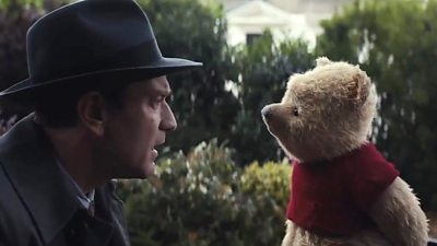 Ewan McGregor (L) and Winnie the Pooh (R) in a scene from Christopher Robin