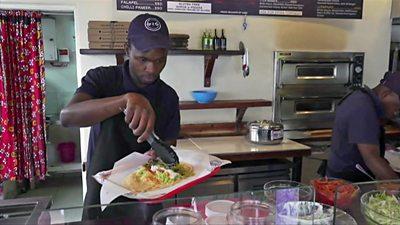 Man serving food in restuarant