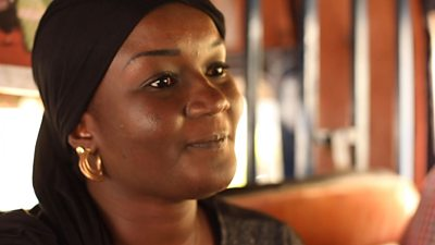 Senegalese woman with black headscarf on a bus