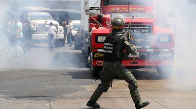 Soldier blocks truck