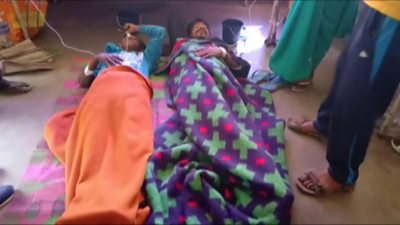 Patients who drank bootleg alcohol are treated in an Assam hospital