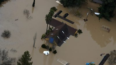 Flooding in California's Sonoma County has left towns cut off and forced thousands of people to evacuate.