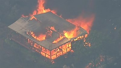 Hundreds of firefighters in Australia are battling bushfires which have destroyed homes.