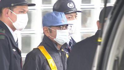 Carlos Ghosn in face mask as he leaves jail