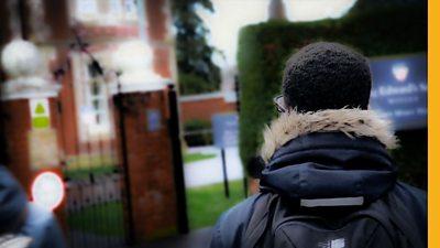 A boy outside a school