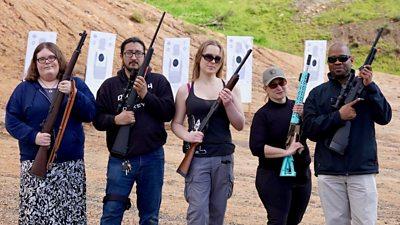 Poeple holding rifles