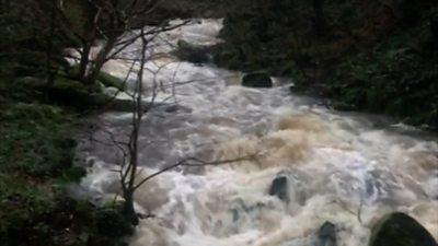 A swollen river in Snowdonia during Storm Gareth