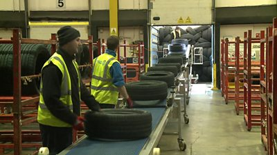 Tyres being delivered at a warehouse