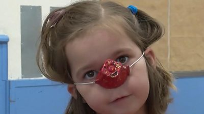 Child with red nose