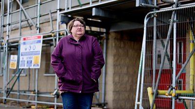 Margaret standing outside her flat