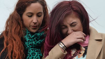 Charlotte Reat is comforted by a woman outside Craigavon courthouse