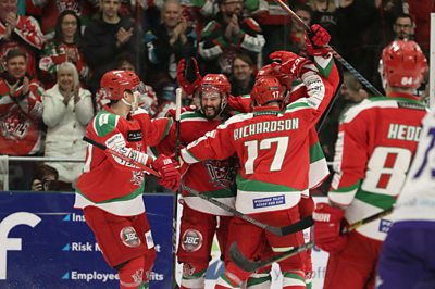 Cardiff Devils celebrate Stephen Dixon's goal in the 3rd period against the Glasgow Clan