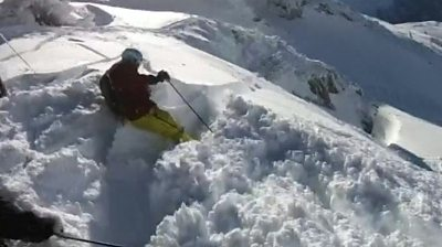 Skiier in an avalanche