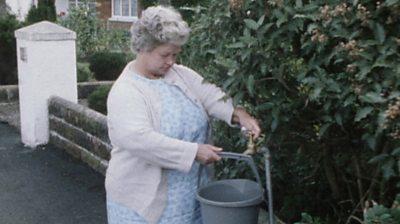 Woman filling bucket