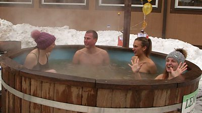 Christa Larwood (L) and other teammates in a hot tub taking part in the European Sauna Marathon