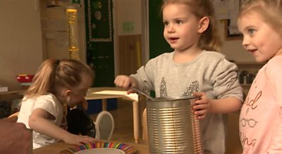 A Bristol nursery has replaced toys with cardboard, tins and train tickets in an attempt to encourage play.