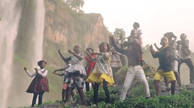 watoto children's choir sing by the waterfall