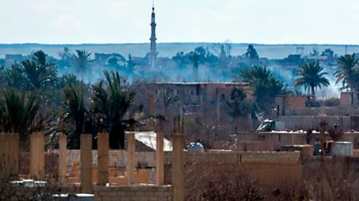 Smoke rises from Baghuz on 17 February 2019