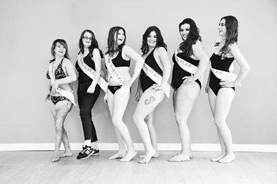 A line of pageant contestants posing