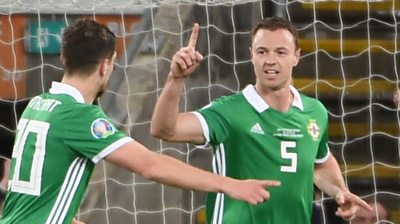 Jonny Evans celebrates his goal against Belarus