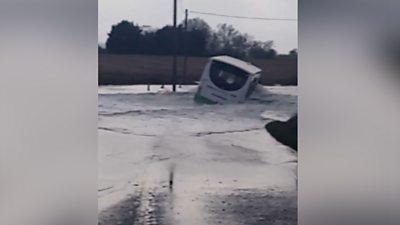 Bus driving through flood water