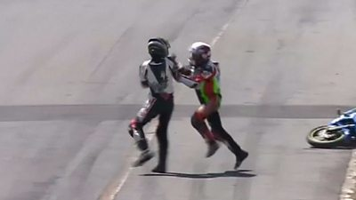 motorcyclists fight mid-race
