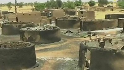Burned out huts in a village
