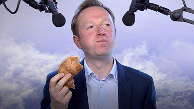 Adam eats a croissant