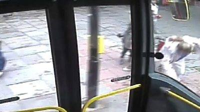 Woman 'pushed' in front of London bus