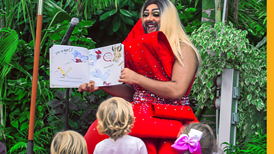 Drag artist The Nightbus reads to children at a Drag Queen Story Time event in Liverpool. She thinks it's important that children hear stories that represent people of colour.